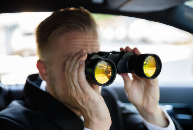 Detective Looking Through a Binoculars